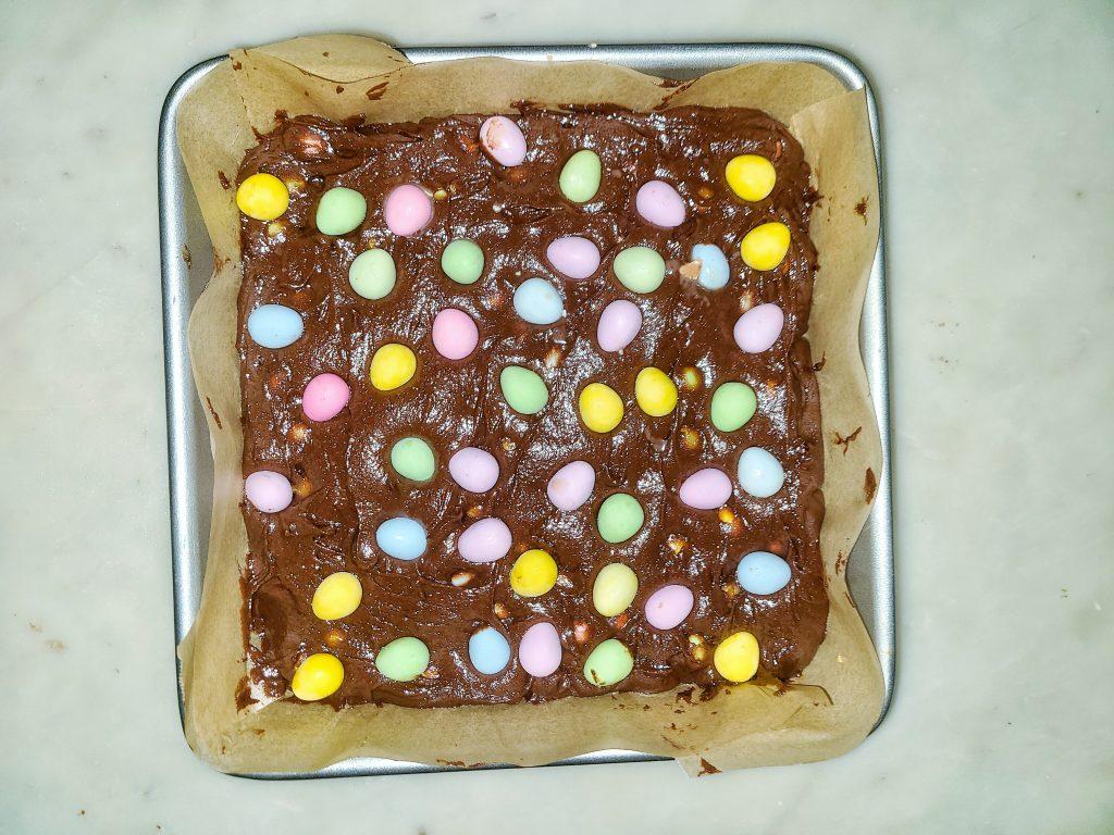 mini egg brownie batter in the pan