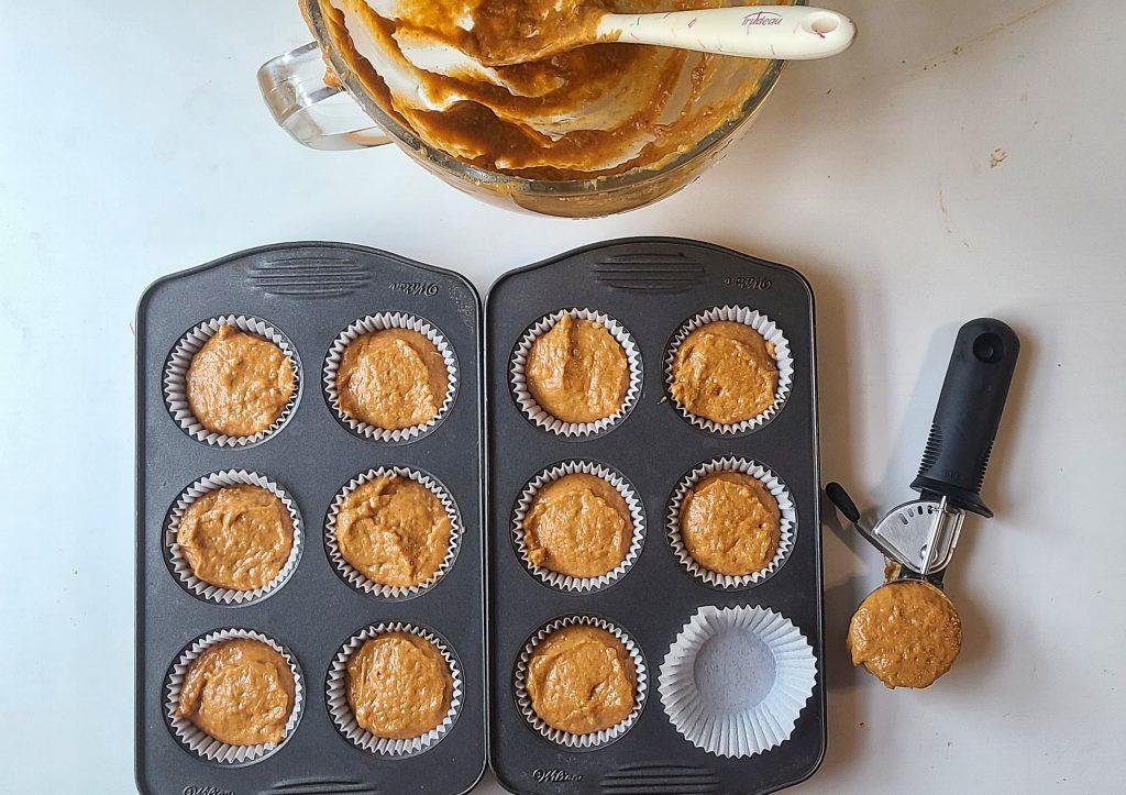 pumpkin crumb muffin batter added to the muffin tin