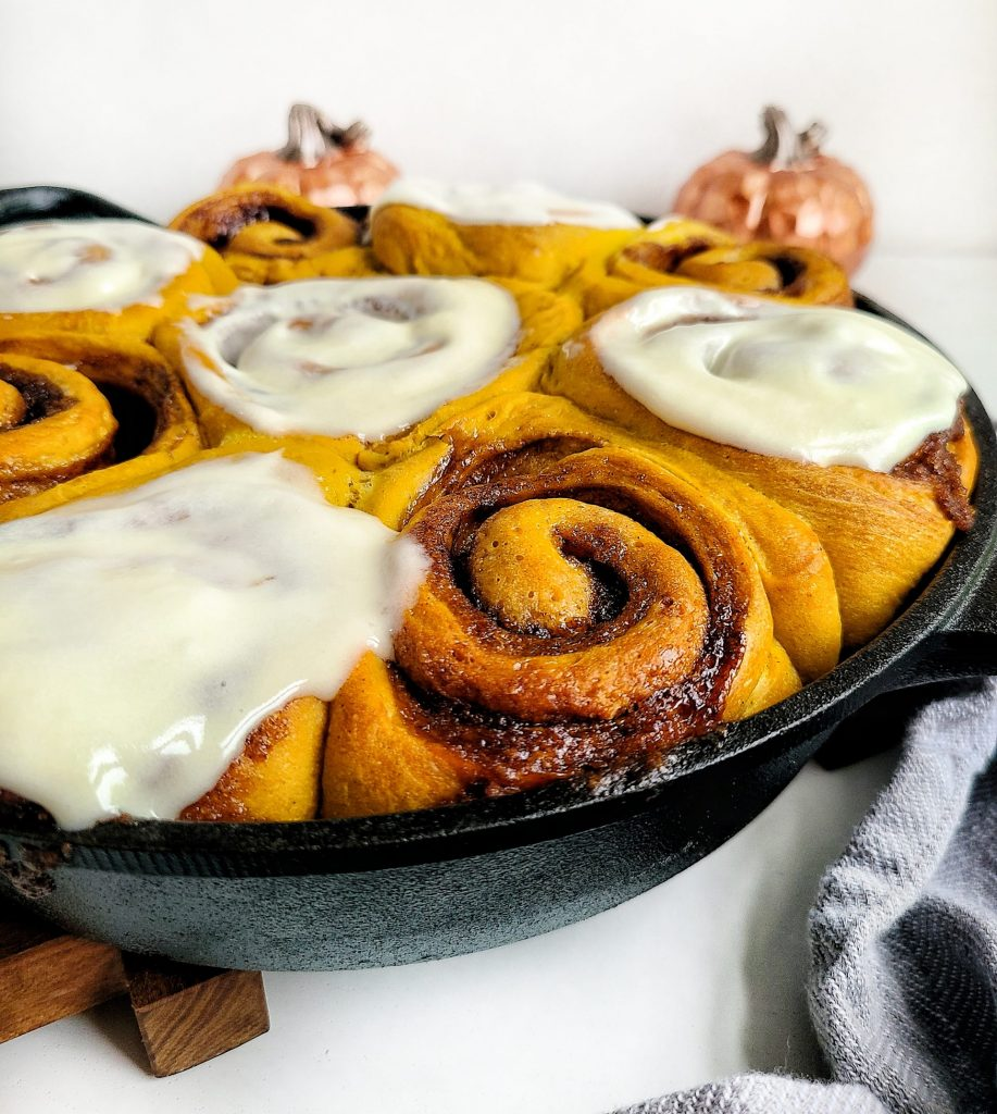 the best pumpkin spice cinnamon rolls with cream cheese frosting