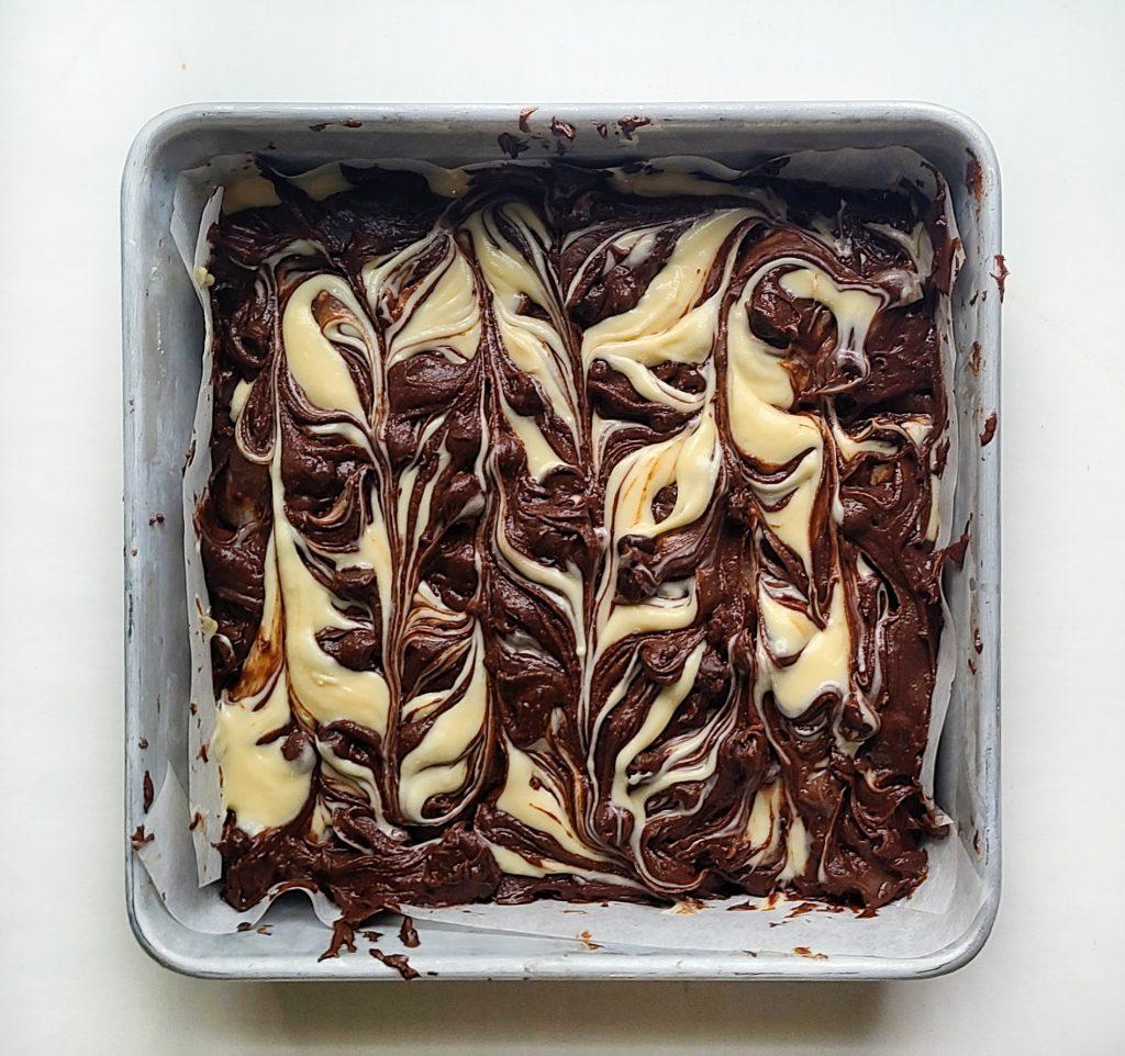 brownie cheesecake batter swirled
